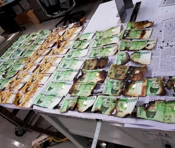 别的简报|为了消毒,一名韩国人用洗衣机洗钱